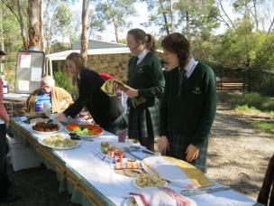 Avila College students serving opening day platter and dampers