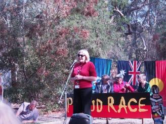 Avila College teacher Michelle Armstrong explaining the story of the bollards